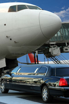 an airport limousine and a jetliner at an airport